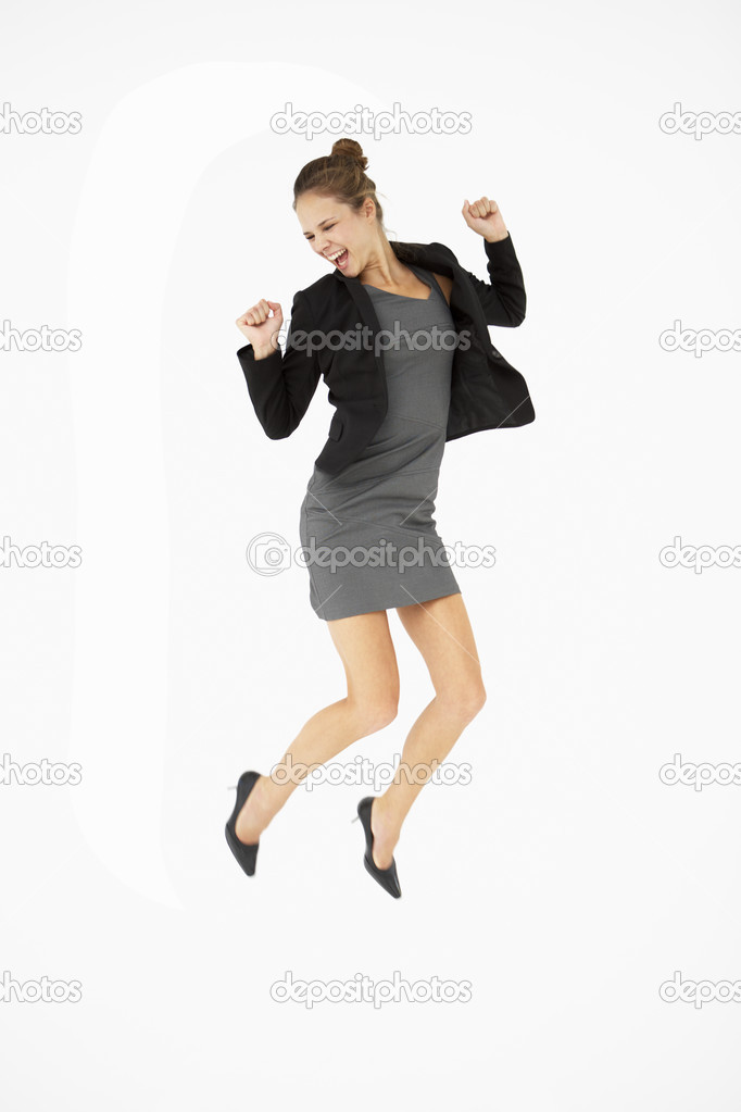 young woman jumping for joy � stock photo 169 monkeybusiness