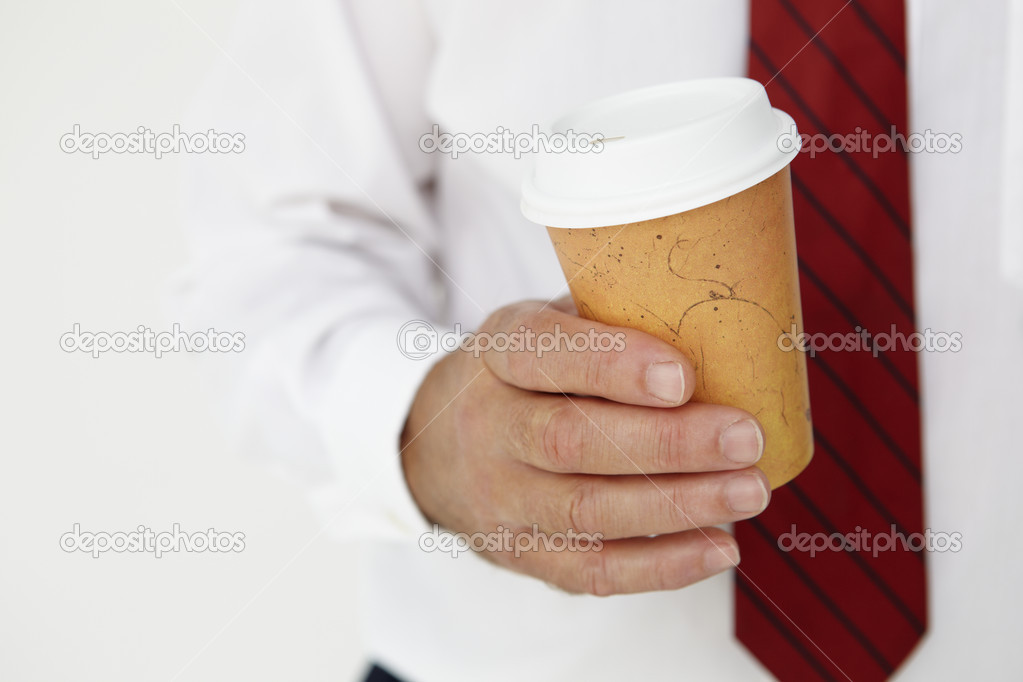Businessman holding takeout coffee — Stock Photo #11883962
