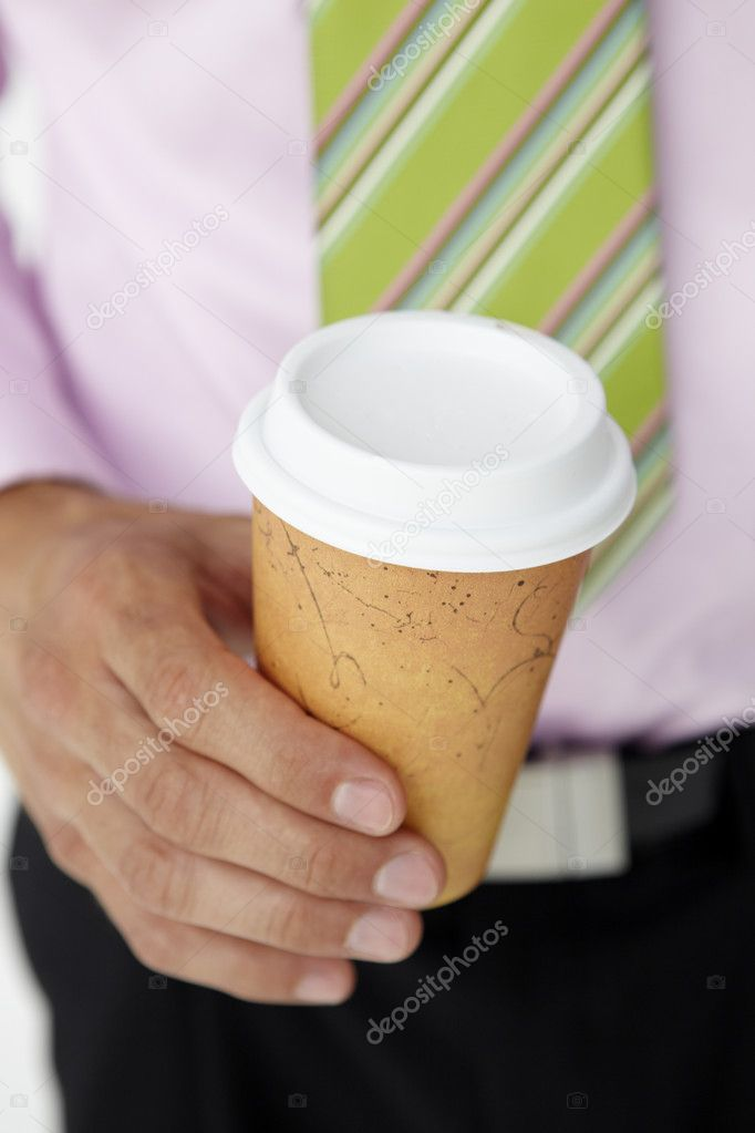 Businessman holding takeout coffee — Stock Photo #11884004