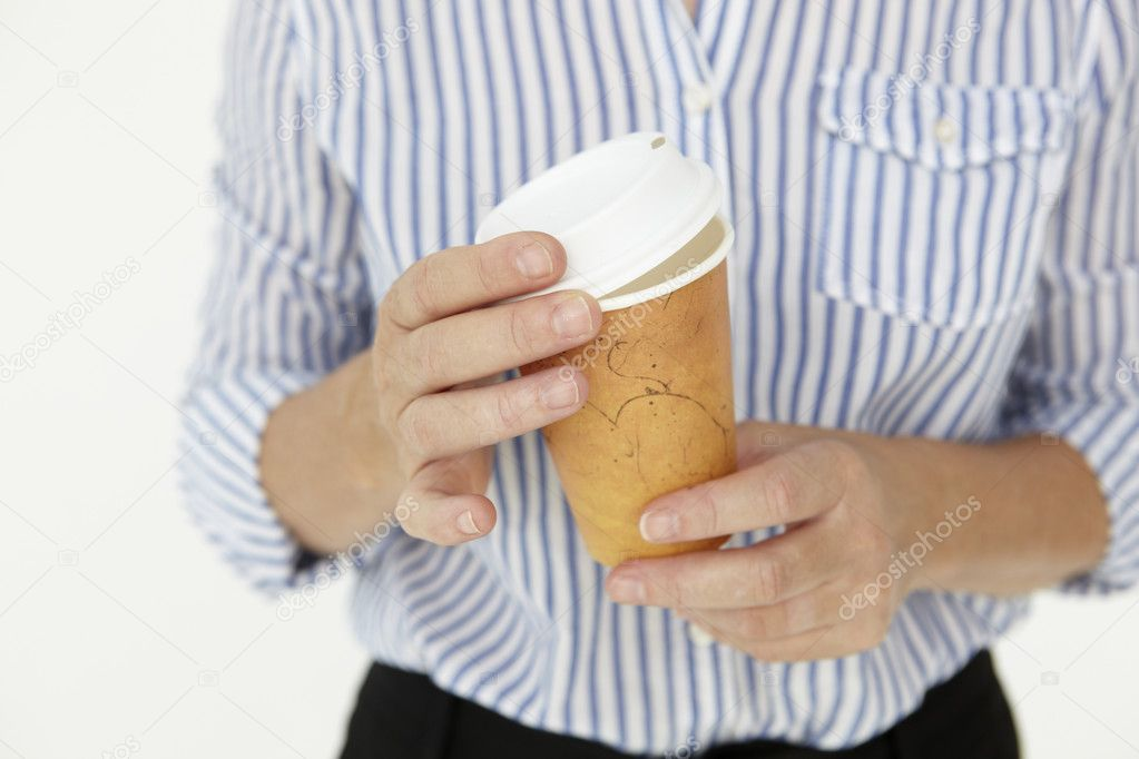 Businesswoman holding takeout coffee — Foto Stock #11884033