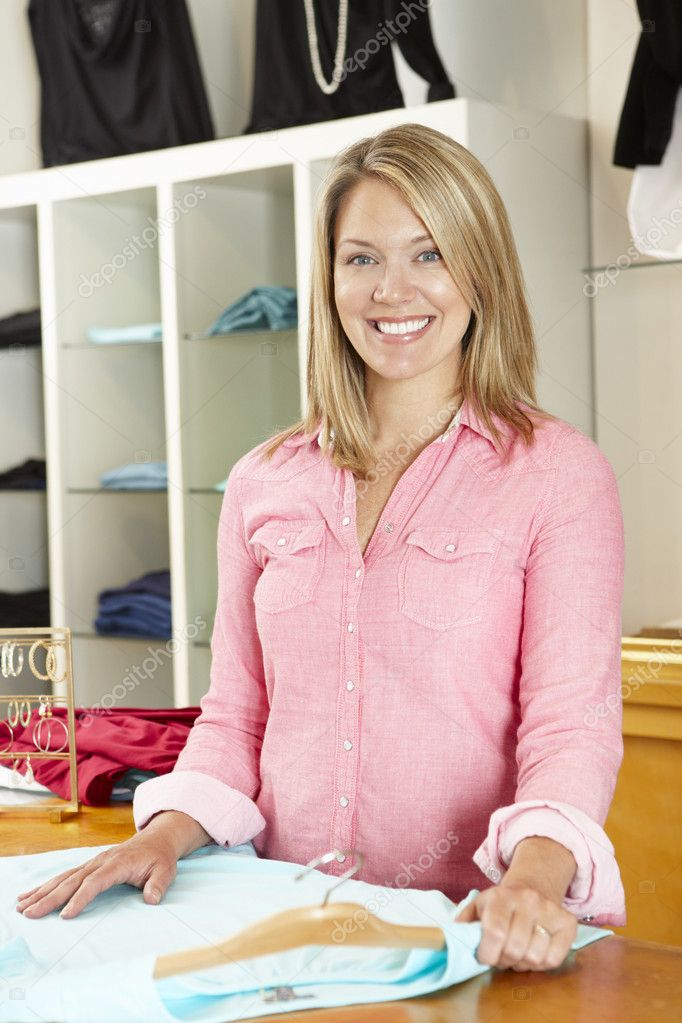 Woman working in fashion store  Foto Stock #11884155