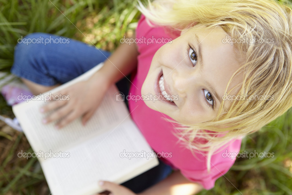 Portrait of happy girl with book — Stock Photo #11885682