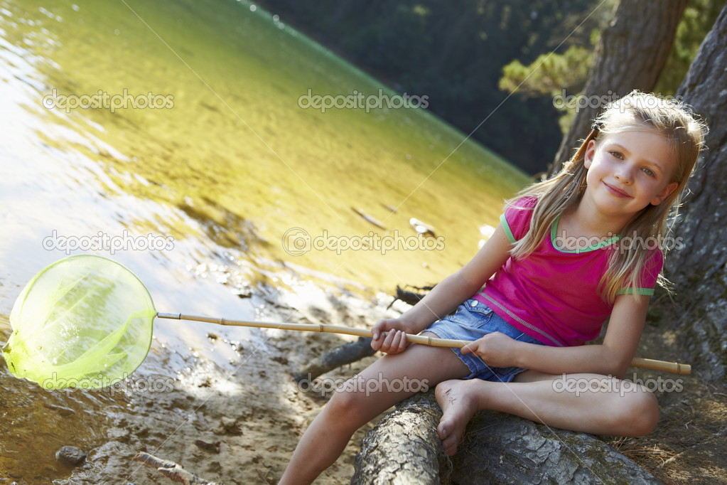 Happy girl fishing at lake — Stock Photo #11885823