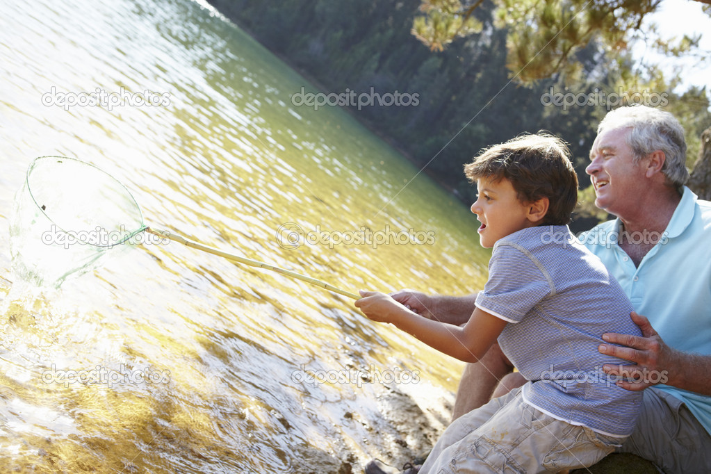 Man and boy fishing together  Stock Photo #11885834