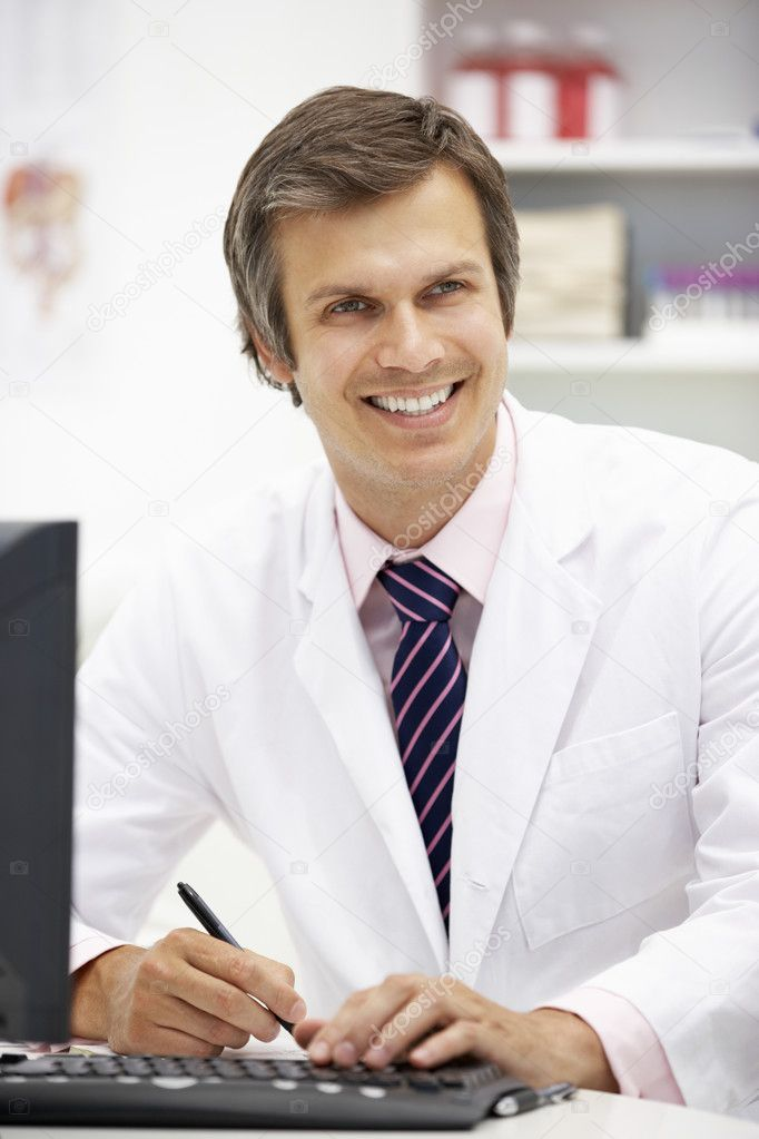 Hospital doctor at desk — Stock Photo #11886299