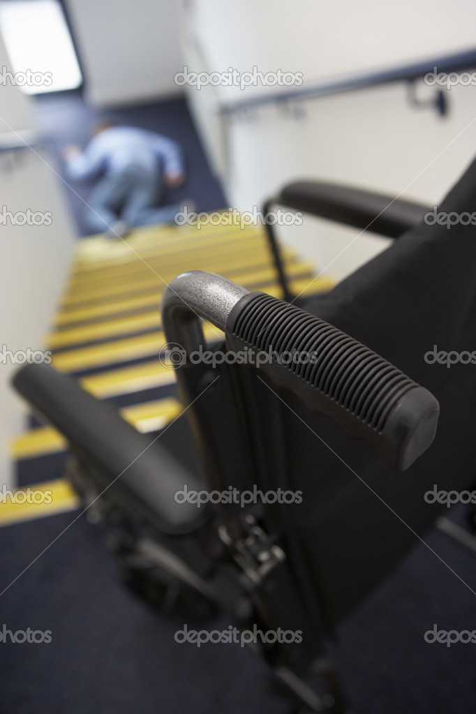 Man in wheelchair falling downstairs — Stock Photo #11886995