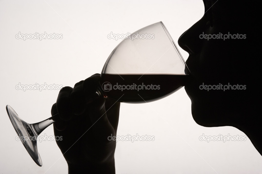 Silhouette man drinking red wine — Stock Photo #11887027