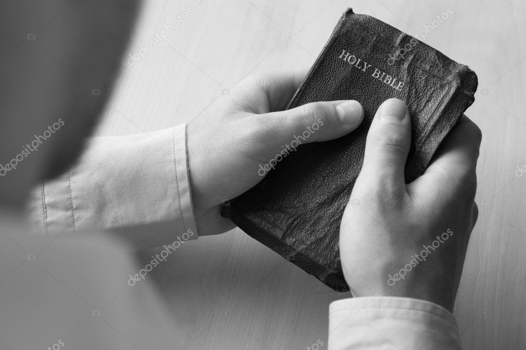 Young man holding bible — Stock Photo #11887056