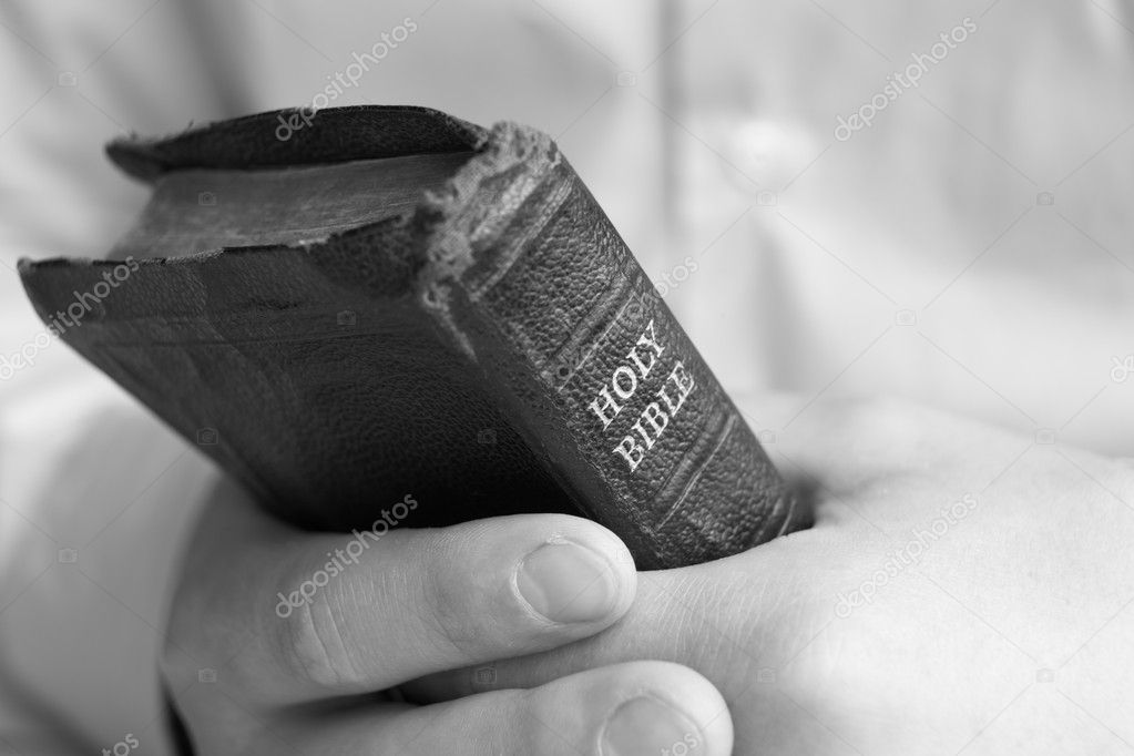 Young man holding bible  Stock Photo #11887059