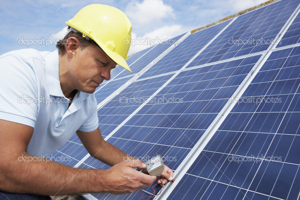 Man installing solar panels  Stock Photo #11887112