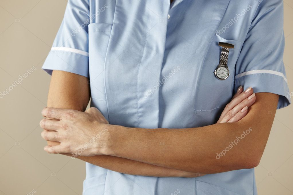 UK nurse standing with arms folded — Stock Photo #11888546