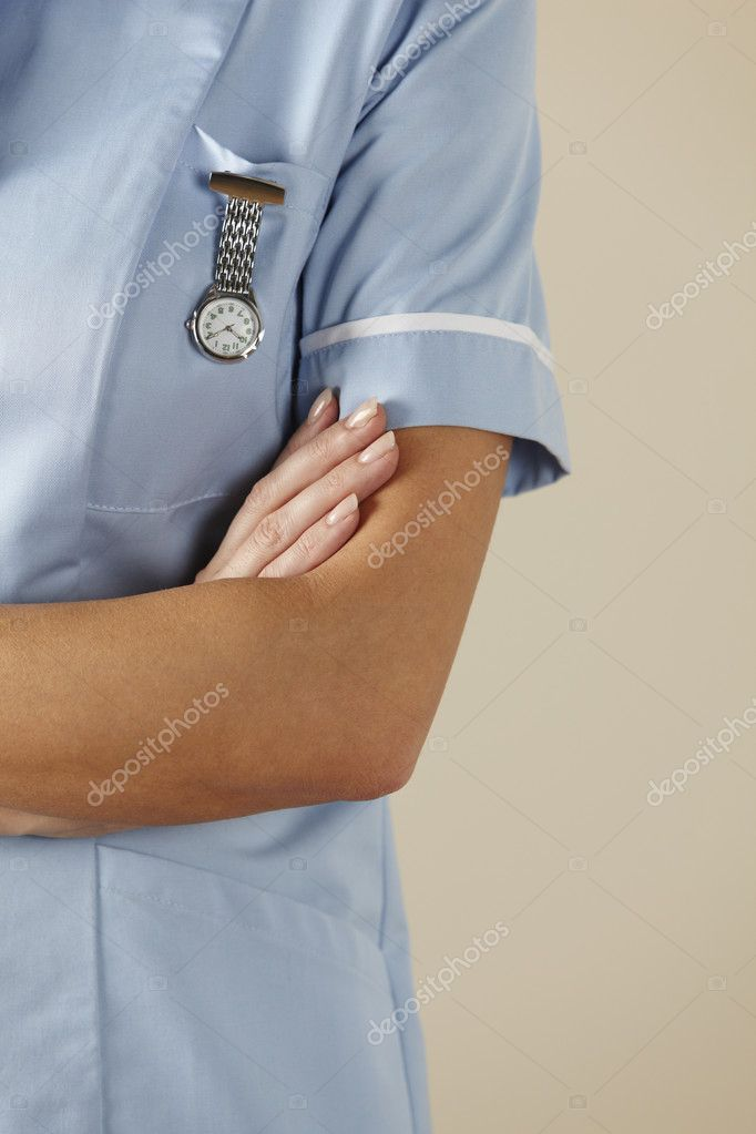 UK nurse standing with arms folded  Stock Photo #11888554