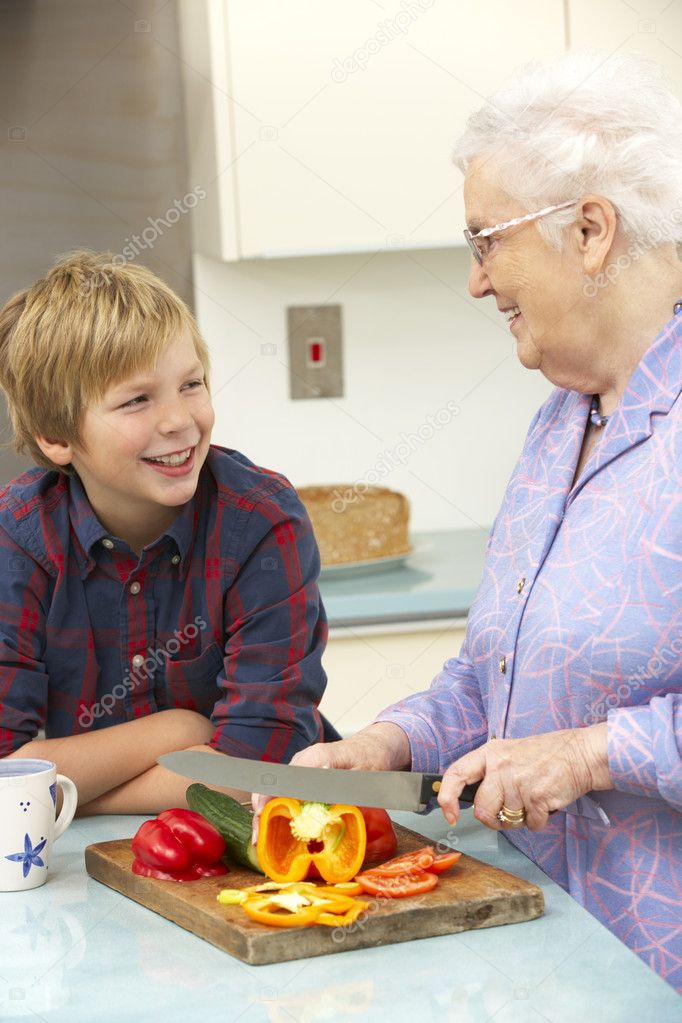 Grandmother and grandson preparing food in kitchen — Foto Stock #11888787