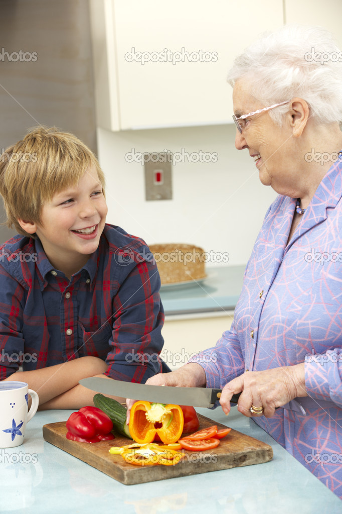 Grandmother and grandson preparing food in kitchen — Stockfoto #11888787