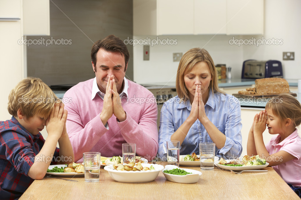 Family saying grace before meal — Stock Photo #11888858