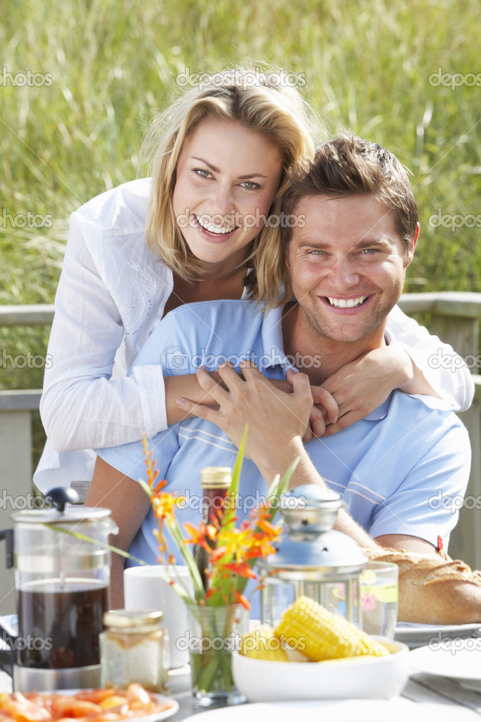 Couple on vacation eating outdoors  Stock Photo #11889619