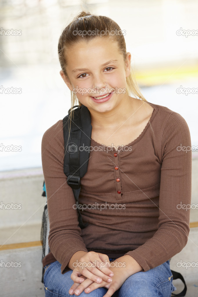Pre teen girl in school - Stock Image