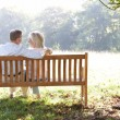 Senior couple sitting outdoors — Stock Photo
