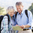Senior couple on country walk - Stockfoto