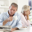 Retired couple eating breakfast — Stock Photo