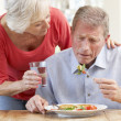 Stock Photo: Senior womlooking after sick husband