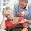 Senior man looking after sick wife - Stock Photo