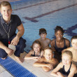 Children having swimming lesson - Foto Stock