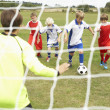 Player ready to score goal in Junior 5 a side - Stock Photo