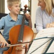 Boy playing cello in music lesson — Stock Photo