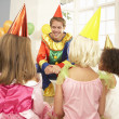 Clown entertaining children at party — Stock Photo