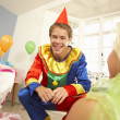Clown entertaining children at party — Foto Stock