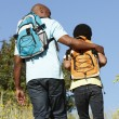 Father and son on country hike - Stockfoto