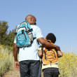 Stock Photo: Father and son on country hike