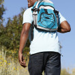 Young  man on country hike - Stock Photo