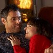 Middle Aged Couple Chatting On Sofa By Cosy Log Fire — Stock Photo #11890538