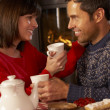Couple Enjoying TeAnd Cake By Cosy Log Fire — Stock Photo #11890949