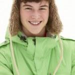 Portrait Of Teenage Boy In Snow Wearing Fur Hat — Stock Photo #11891152