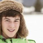 Portrait Of Teenage Boy In Snow Wearing Fur Hat — Stock Photo #11891154