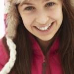 Teenage Girl Holding Snowball Wearing Fur Hat — Stock Photo #11891181