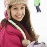 Teenage Couple Having Snowball Fight Wearing Fur Hats — Stock Photo
