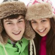 Portrait Of Teenage Couple In Snow Wearing Fur Hats — Stock Photo #11891196