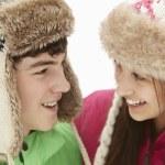 Teenage Couple In Snow Wearing Fur Hats — Stock Photo