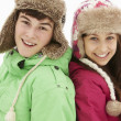Portrait Of Teenage Couple In Snow Wearing Fur Hats — Stock Photo