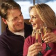 Middle Aged Couple Sitting On Sofa With Glasses Of Champagne — Stock Photo #11891348