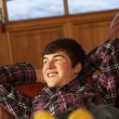 Stock Photo: Teenage Boy Relaxing On Sofa