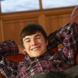 Teenage Boy Relaxing On Sofa — Foto Stock