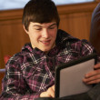 Teenage Boy Relaxing On Sofa With Tablet Computer — Stock Photo #11891506