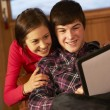 Teenage Couple Relaxing On Sofa With Tablet Computer — Stock Photo