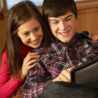 Teenage Couple Relaxing On Sofa With Laptop — Stock Photo