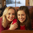 Portrait Of Mother And Daughter Relaxing On Sofa Together — Stock Photo #11891572